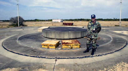 U.S. Air Force staff sergeant Thomas Czerwinski stands next to one of two Minuteman missile silos February 6, 2003 where the debris of the space shuttle Challenger is buried on the Cape Canaveral Air Force Station in Cape Canaveral, Florida. (Reuters/Joe Skipper)