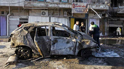People gather at the site of a car bomb attack in Baghdad's al-Sinaa district November 9, 2014. (Reuters/Ahmed Saad)