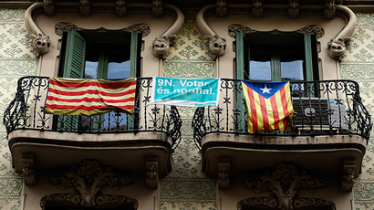 "A pro-Catalan independence flag (R) known as the ""Estelada"" hangs from a balcony in central Barcelona as Catalonia participates in a symbolic independence vote November 9, 2014. (Reuters / Paul Hanna)"
