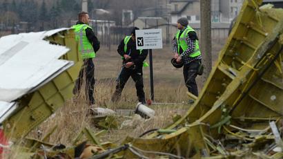 Dutch experts work at Malaysia Airlines Flight MH17 Amsterdam - Kuala Lumpur crash site. (RIA Novosti / Alexey Kudenko)