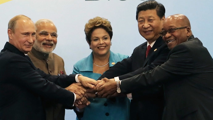 (L-R) Russian President Vladimir Putin, Indian Prime Minister Narendra Modi, Brazilian President Dilma Rousseff, Chinese President Xi Jinping and South African President Jacob Zuma join their hands at a group photo session.(Reuters / Nacho Doce)