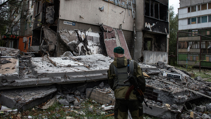Ukraine scraps human rights treaty for rebel areas, cuts services, freezes banks
