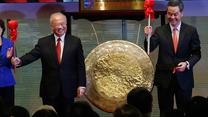 Hong Kong Exchanges and Clearing Ltd. Chairman Chow Chung-kong (L) and Hong Kong Chief Executive Leung Chun-ying smile after hitting a gong during the launch ceremony of the Shanghai-Hong Kong Stock Connect in Hong Kong November 17, 2014.(Reuters / Bobby Yip)