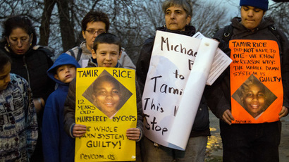 People display sigs at Cudell Commons Park in Cleveland, Ohio, November 24, 2014 during a rally for Tamir Rice, a 12-year-old boy shot by police on November 23. (AFP Photo/Jordan Gonzalez)