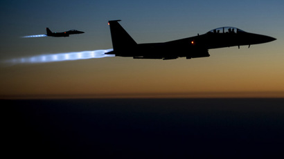 A pair of U.S. Air Force F-15E Strike Eagles fly over northern Iraq after conducting airstrikes in Syria, in this U.S. Air Force handout photo (Reuters/U.S. Air Force)