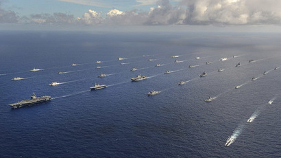 More than 40 ships and submarines representing 15 international partner nations travel in formation in the Pacific Ocean during the Rim of the Pacific (RIMPAC) 2014 exercise in this U.S. Navy photo taken July 25, 2014. (Reuters/U.S. Navy)