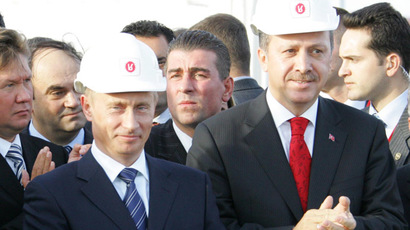 Russian President Vladimir Putin and Turkish Prime Minister Recep Erdogan lighting the symbolic torch at the jhtning of the Blue Stream gas pipeline, passing along the Black Sea bed. (RIA Novosti/Sergey Zhukov)