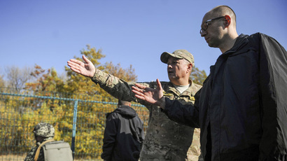 "Ukrainian Prime Minister Arseny Yatseniuk (R) listens to explanations as he inspects the ""Wall"" project, which should reinforce the border with Russia, near Hoptivka border checkpoint in Kharkiv region, October 15, 2014. (Reuters/Andrew Kravchenko)"