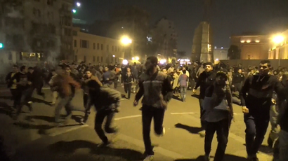 Protesters run as Egyptian police fire tear gas and water cannon in Cairo's Abdel Moneim Riad Square on November 29, 2014 (A still from AP video)
