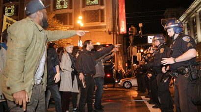 Protesters face off with police in front of the Westfield Mall during a demonstration against the grand jury's decision in the Ferguson shooting of Michael Brown, in San Francisco, California November 28, 2014.(Reuters / Elijah Nouvelage)
