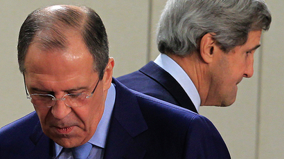 U.S. Secretary of State John Kerry (R) walks behind Russian Foreign Minister Sergey Lavrov (Reuters / Yves Herman)
