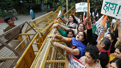 Members of All India Mahila Congress, women's wing of Congress party, shout slogans and carry placards next to a police barricade during a protest against the rape of a female passenger, in New Delhi December 8, 2014 (Reuters / Anindito Mukherjee)