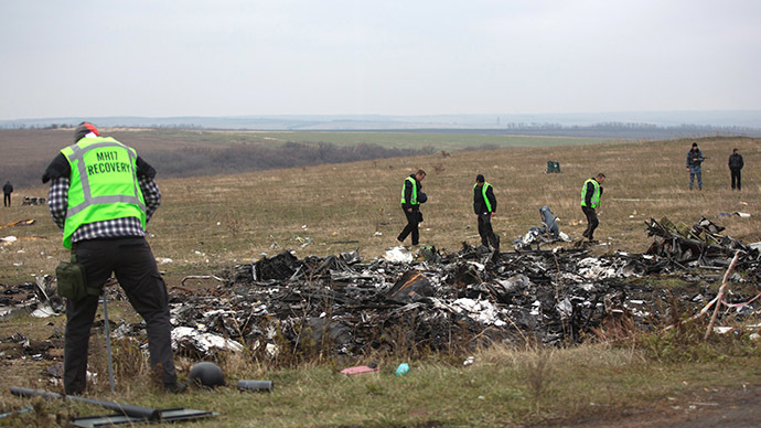 Dutch investigators inspect parts of the Malaysia Airlines Flight MH17 plane at the crash site near the Grabove village in eastern Ukraine. (AFP Photo/Menahem Kahana)