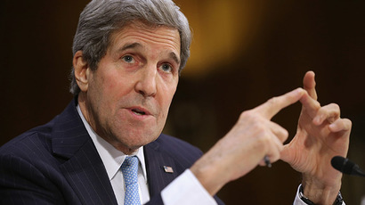 Secretary of State John Kerry testifies about a congressional Authorization for the Use of Military Force against the Islamic State, December 9, 2014 in Washington, DC. (AFP Photo/Chip Somodevilla)