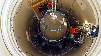 A US Air Force missile maintenance team removes the upper section of an intercontinental ballistic missile with a nuclear warhead in an undated USAF photo at Malmstrom Air Force Base, Montana (Reuters)