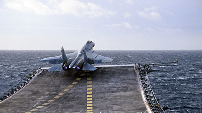 A Sukhoi Su-27K fighter takes off from the heavy aircraft carrying cruiser Admiral Kuznetsov of the Russian Northern Fleet.(RIA Novosti / Oleg Lastochkin)
