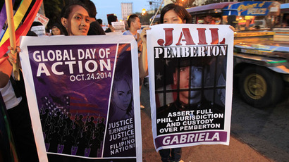 Protesters display banners seeking justice for murdered Filipino transgender Jeffrey Laude, who also goes by the name Jennifer, during a protest along a main street of Manila October 24, 2014. (Reuters/Romeo Ranoco)
