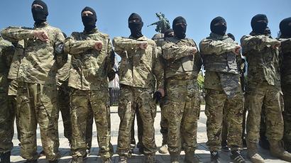 Azov battalion soldiers take an oath of allegiance to Ukraine in Kiev's Sophia Square before being sent to the Donbass region. (RIA Novosti / Evgeny Kotenko)