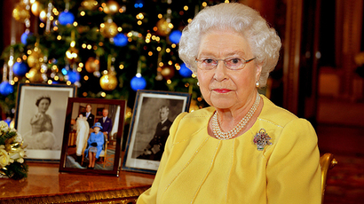 Britain's Queen Elizabeth poses for a photograph after recording her Christmas Day broadcast to the Commonwealth, in the Blue Drawing Room at Buckingham Palace, in central London December 12, 2013 (Reuters / John Stillwell)