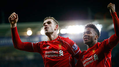 Liverpool's Jordan Henderson (L) celebrates with Raheem Sterling after scoring his team's third goal during their English Premier League soccer match against Leicester City at the King Power Stadium in Leicester, central England, December 2, 2014 (Reuters / Darren Staples)