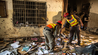 Rescue team members go through debris inside the Army Public School, which was attacked by Taliban gunmen, in Peshawar, December 17, 2014.(Reuters / Zohra Bensemra)