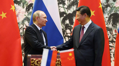 Russia's President Vladimir Putin (L) and his Chinese counterpart Xi Jinping. (AFP Photo/How Hwee Young)
