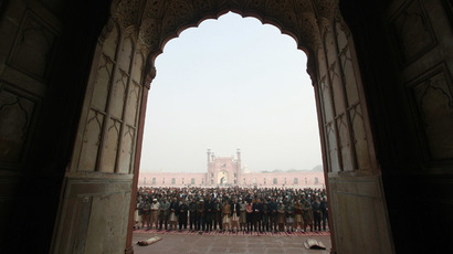 People hold funeral prayers for the victims of the Taliban attack on the Army Public School in Peshawar, at the Badshahi Mosque in Lahore, December 17, 2014. (Reuters/Mohsin Raza)