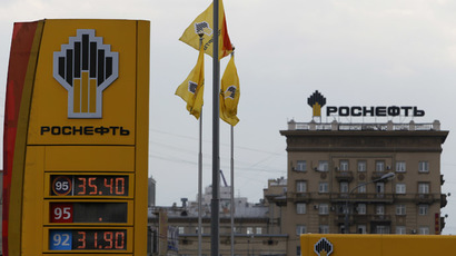 The logo of Russia's top crude producer Rosneft is seen on a price information board of a gasoline station in Moscow. (Reuters/Sergei Karpukhin)