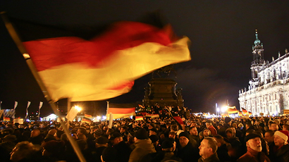 "Participants hold German national flags during a demonstration called by anti-immigration group PEGIDA, a German abbreviation for ""Patriotic Europeans against the Islamization of the West"", outside Semperoper opera house in Dresden December 22, 2014. (Reuters / Hannibal Hanschke)"