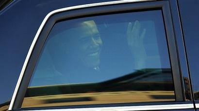 President Barack Obama waves outside his presidential motorcade window (Reuters/Shannon Stapleton)