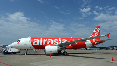 Search for missing AirAsia flight resumes as 24 hours pass