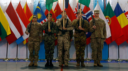 Afghan and NATO-led International Security Assistance Force (ISAF) soldiers stand at attention during the change of mission ceremony in Kabul, December 28, 2014. (REUTERS / Omar Sobhani)
