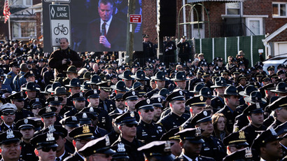 Law enforcement officers turn their backs on a live video monitor showing New York City Mayor Bill de Blasio as he speaks at the funeral of slain New York Police Department (NYPD) officer Rafael Ramos near Christ Tabernacle Church in the Queens borough of New York December 27, 2014.(Reuters / Shannon Stapleton)