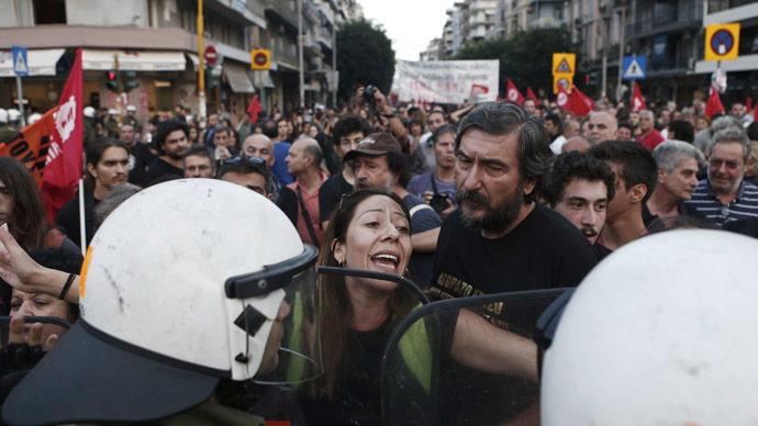 A protester shouts at police officers during a rally against austerity measures in the city of Thessaloniki September 6, 2014. (Reuters/Alkis Konstantinidis)