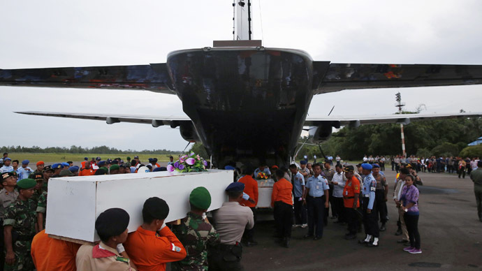 Caskets containing the remains of AirAsia QZ8501 passengers recovered from the sea are carried to a military transport plane before being transported to Surabaya, where the flight originated, at the airport in Pangkalan Bun, Central Kalimantan January 2, 2015.(Reuters/Darren Whiteside)