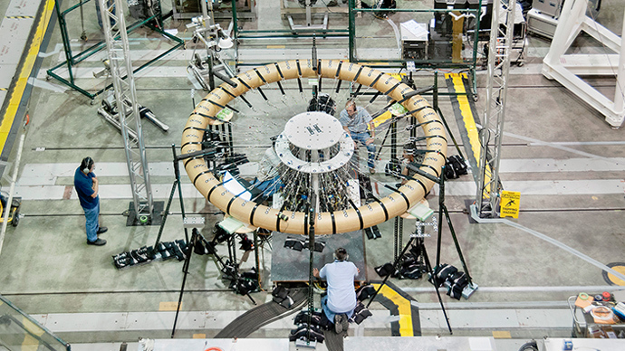 "Technicians prepare a ""donut"" test article for the Hypersonic Inflatable Aerodynamic Decelerator structural loads testing in NASA Armstrong's Flight Loads Laboratory (Image from nasa.gov)"