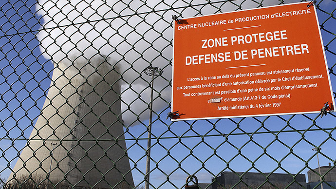 "A picture taken in Nogent-sur-Seine shows a sign reading ""proctected area, no tresspassing"" on the wires fence of the French nuclear plant. (AFP Photo/Francois Nascimbeni)"