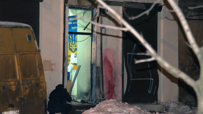 A police officer seen at the window of the volunteer сenter in Odessa blown off by a shock wave. (RIA Novosti/Denis Petrov)