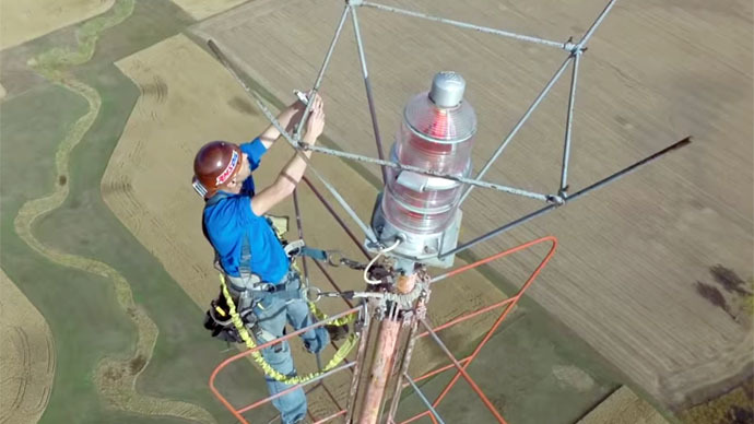 ​Stunning drone footage shows man changing light bulb at 1,500 feet