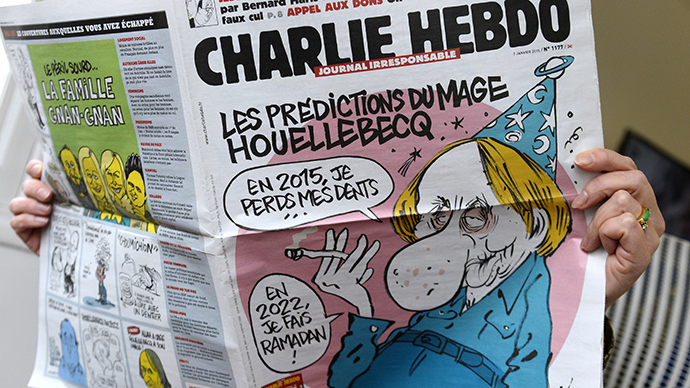A person reads the latest issue of the French satirical newspaper Charlie Hebdo in Paris on January 7, 2015, after gunmen armed with Kalashnikovs and a rocket-launcher opened fire in the offices of the weekly in Paris, killing at least 11 (AFP Photo / Bertrand Guay)