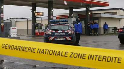 A Gendarmerie cordon is seen at a gas station in Villers-Cotterets, north-east of Paris, January 8, 2015, where armed suspects from the attack on French satirical weekly newspaper Charlie Hebdo were spotted in a car. (Reuters/Pascal Rossignol)