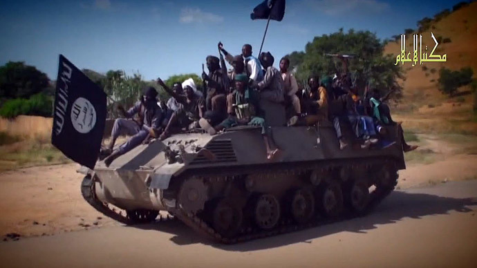 Boko Haram fighters parading on a tank in an unidentified town.(AFP Photo / HO)