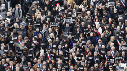 "Tens of thousands of people some holding up signs that read, ""Je suis Charlie"" march during a rally along the sea front in the Mediterranean city of Nice, on January 10, 2015.(AFP Photo / Valery Hache)"