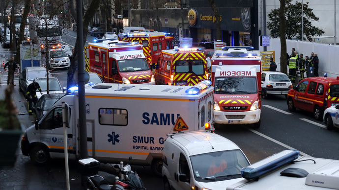 Rescue service workers and firefighters gather near the site of a shooting on the morning of January 8, 2015 in Montrouge, south of Paris. (AFP Photo / Thomas Samson)