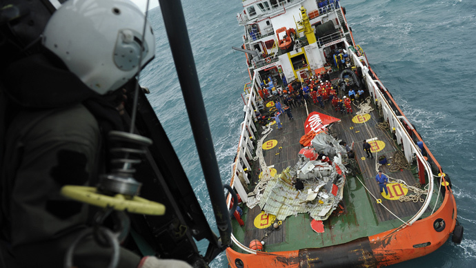 The tail of the AirAsia QZ8501 passenger plane lies on the deck of the Indonesian Search and Rescue (BASARNAS) ship Crest Onyx after it was recovered at sea on January 10, 2015. (AFP Photo / Prasetyo Utomo / Pool)