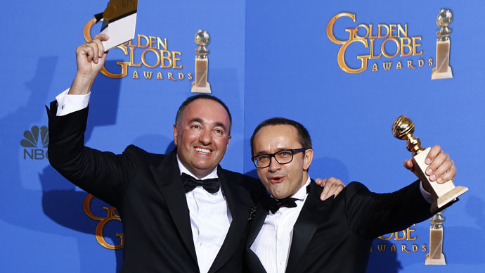 "Producer Alexander Rodnyansky (L) and director Andrey Zvyagintsev pose backstage with their award for Best Foreign Language Film for their film ""Leviathan"" at the 72nd Golden Globe Awards in Beverly Hills, California January 11, 2015. (Reuters/Mike Blake)"