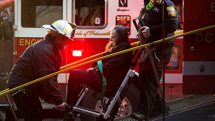 Washington, DC, firefighters load a victim into a medical bus after passengers on the Washington METRO (subway) service January 12, 2015, were injured when smoke filled the L'Enfant Plaza station during the rush hours. (AFP Photo/Paul J. Richards)