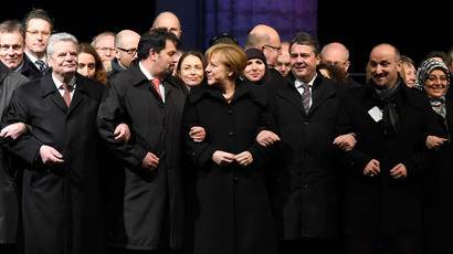 (L-R) German President Joachim Gauck, the chairman of the Central Council of Muslims in Germany Aiman Mazyek, German Chancellor Angela Merkel, German vice-chancellor Sigmar Gabriel and other political and religious leaders stand together as they attend a Muslim community rally to condemn the Paris jihadist attacks, promote tolerance and send a rebuke to a growing anti-Islamic movement, on January 13, 2015 in front of the Brandenburg Gate in Berlin.(AFP Photo / Tobias Schwarz)