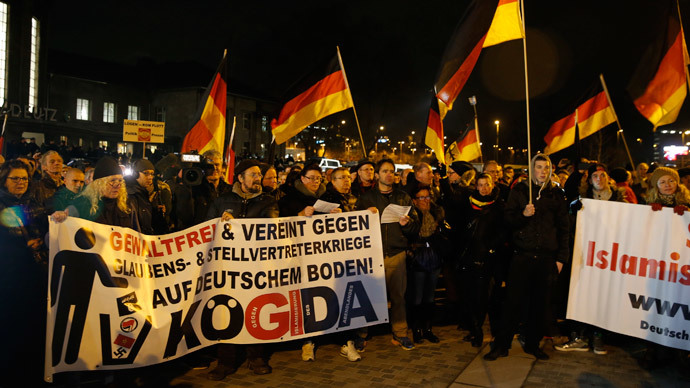 People take part in a march of a grass-roots anti-Muslim movement in Cologne January 5, 2015.(Reuters / Wolfgang Rattay)
