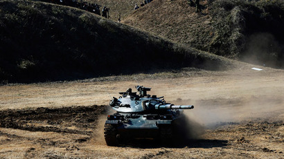 A Japanese Ground Self-Defense Force (JGSDF) Type 74 armoured tank takes part in an annual new year military exercise with the JGSDF 1st Airborne Brigade at Narashino exercise field in Funabashi, east of Tokyo January 11, 2015. (Reuters / Yuya Shino)